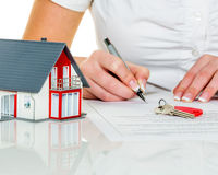 Woman signs agreement for house Royalty Free Stock Images
