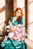 Woman siiting near window, vintage interior, luxury, flowers Stock Photography