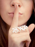 Woman with silence sign on lips Royalty Free Stock Photography