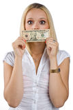Woman silenced with dollar bill on her mouth Stock Image