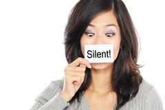 Woman with silent paper. Beautiful Asian woman looking surprised and scared cover her mouth with paper. silent word Royalty Free Stock Images