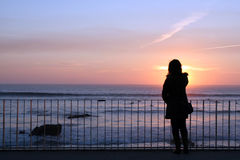 Woman silhouette. Silhouette of a woman looking at the ocean Stock Image