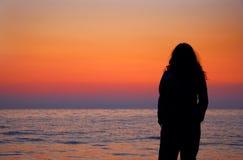 A woman silhouette. At dusk stock photos