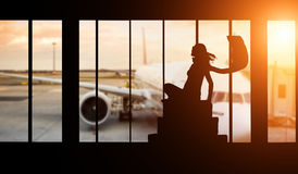 Woman silhouette at Airport - Concept of travel Royalty Free Stock Photography