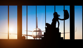 Woman silhouette at Airport - Concept of travel Stock Photos