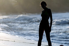 Woman silhouette at the beach Royalty Free Stock Image