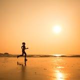 Woman silhouette on the beach stock photos