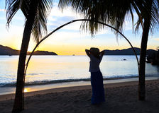 Woman silhouette at the beach Stock Image
