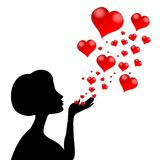 Woman Silhouette Blowing Hearts Stock Images