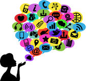 Woman Silhouette Blowing Social Media Communicatio. Illustration featuring a woman silhouette blowing speech bubble made of different  conceptual social media Stock Image