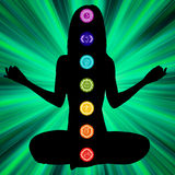 Woman silhouette with chakras on here body. EPS8 Stock Photos