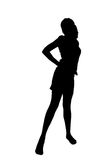 Woman silhouette in a cool pose Stock Photography