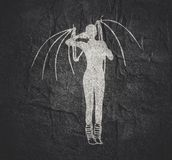 Woman silhouette in dress. Woman silhouette with bone wings standing royalty free stock photo