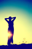 Woman silhouette. In front of a sunset Stock Image