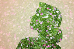 Woman silhouette with green floral pattern Royalty Free Stock Image