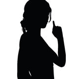 woman silhouette with hand gesture finger pointing upwards Royalty Free Stock Photos
