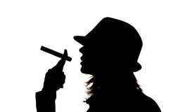 Woman silhouette holding a cigar Stock Images