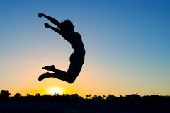 Woman Silhouette Jumping Stock Photography