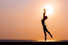 Woman silhouette jumping on sea background Royalty Free Stock Photo