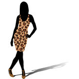 Woman silhouette in leopard skin dress Royalty Free Stock Photos