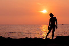 Woman silhouette on sea background back lit. Woman silhouette on sunset sea background back lit stock image