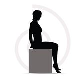 Woman silhouette on sofa Royalty Free Stock Image