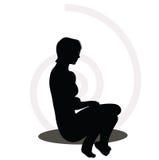 Woman silhouette on sofa Royalty Free Stock Photos