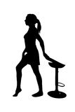 Woman silhouette - standing near a chair Royalty Free Stock Image