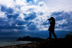 Woman silhouette standing on top Royalty Free Stock Photos