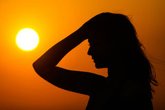 Woman silhouette on sunset Stock Photos