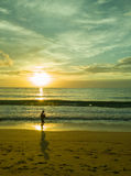 woman silhouette using a smart phone at sunset on the beach in phuket, Thailand Royalty Free Stock Photo