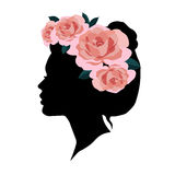 Woman silhouette with wreath of pink roses on her head. Royalty Free Stock Images