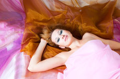Woman in silk Royalty Free Stock Image