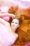 Woman in silk Royalty Free Stock Photography