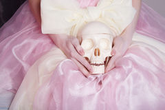 Woman in a silk dress holds a skull royalty free stock photos