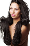Woman with silky black hair Stock Images