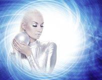 Woman with a silver ball Royalty Free Stock Images