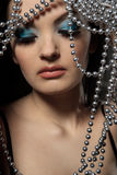 Woman with silver beads Stock Photo