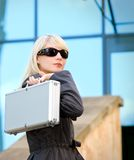 Woman with silver case Stock Photo