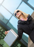 Woman with silver case Stock Image
