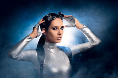 Woman in Silver Costume and Steampunk Glasses