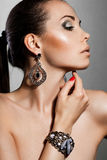 Woman with silver jewelry Royalty Free Stock Photo