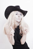Woman with silver make-up in a cowboy hat Royalty Free Stock Image
