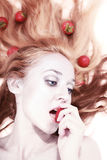 Woman with silver makeup eating strawberries Royalty Free Stock Photo