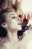 Woman with silver makeup eating strawberries Stock Image