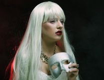 Woman with silver mask Stock Image