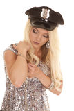 Woman silver outfit police hat handcuffs on wrist Royalty Free Stock Image