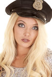 Woman silver outfit police hat head serious Stock Photography