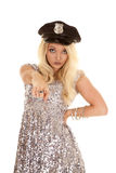 Woman silver outfit police hat pointing Stock Images