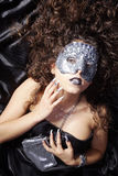 Woman with silver rhinestone mask Stock Image